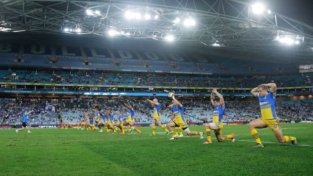 Stretched out: Eels players prepare for the round three match against the Canterbury Bulldogs