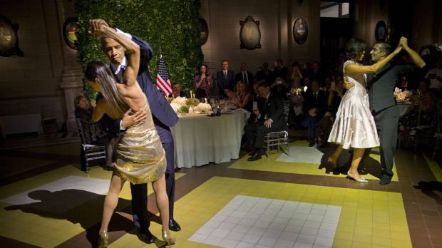 President Barack Obama and First Lady Michelle Obama, right, dance the tango with professional dancers at the state ...