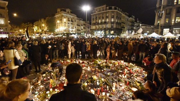 Hundreds of people come together at Place de la Bourse in Brussels to mourn on Wednesday evening.