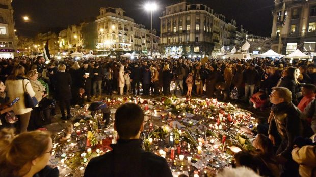 Hundreds of people come together at Place de la Bourse in Brussels to mourn the victims.