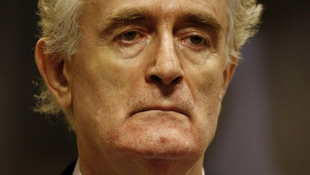 Former Bosnian Serb leader Radovan Karadzic stands in the courtroom during his initial appearance in 2008 at the UN's ...