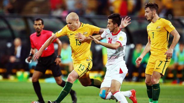On the run: Aaron Mooy  gets set to pass during the World Cup qualifier against Tajikistan in Adelaide on Thursday night.