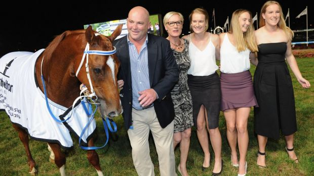 Going out a winner: Trainer Peter Moody poses with his family after Flamberge won  the William Reid Stakes at Moonee ...