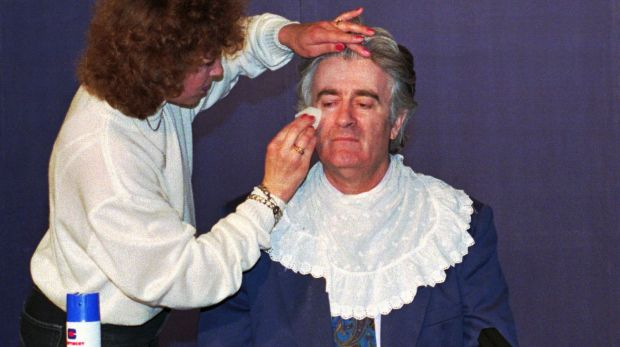 Karadzic gets ready for a live TV appearance in 1995.