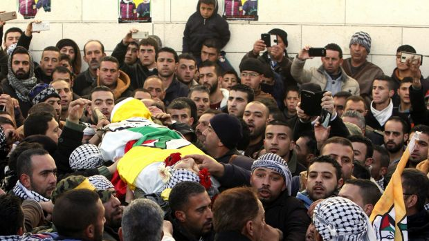 Palestinians carry the body of Ali Taqatqah, 19, at his funeral in the village of Beit Fajjar, near the West Bank city ...