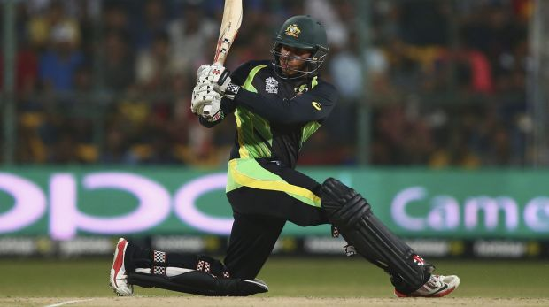 Hitting out: Usman Khawaja swings hard for Australia against Bangladesh.