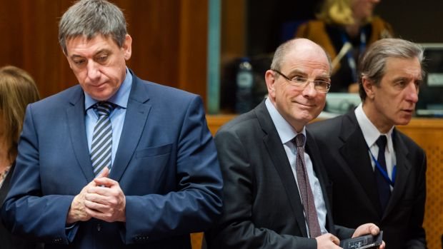 Belgian Interior Minister Jan Jambon, left, and Justice Minister Koen Geens, centre, arrive for an extraordinary meeting ...