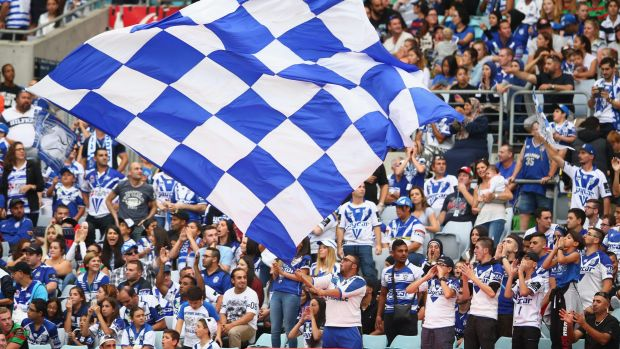 Happy bunch this Good Friday: Bulldogs supporters cheer during the round four NRL match between the South Sydney ...