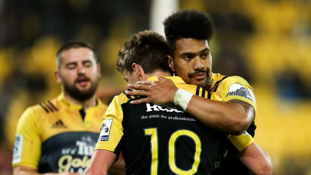 In the bag: Ardie Savea of the Hurricanes congratulates Beauden Barrett on his try.