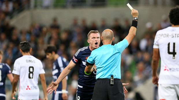 Victory's Besart Berisha argues with the referee after he was given a yellow card.
