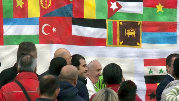Pope Francis, centre, arrives to celebrate the Coena Domini mass and foot-washing ceremony at the Castelnuovo di Porto ...