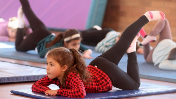 Children doing yoga over the school holidays.