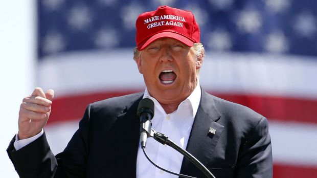 Donald Trump on the campaign trail in one of the signature baseball caps.