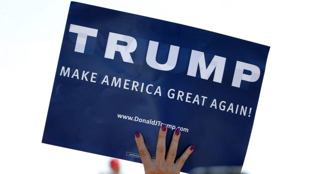 A supporter holds a sign backing Donald Trump at a rally in Arizona.