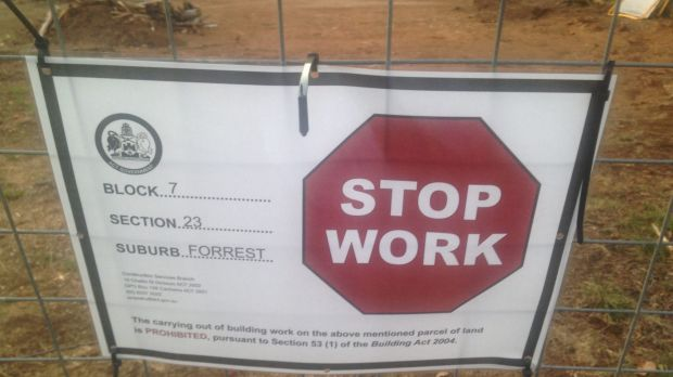 The stop work notice on the Forrest property, with the cleared section of the block in the background.