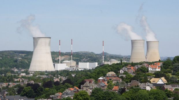 A guard who worked at a Belgian nuclear plant has been  murdered and his pass stolen. Pictured is Tihange nuclear power ...