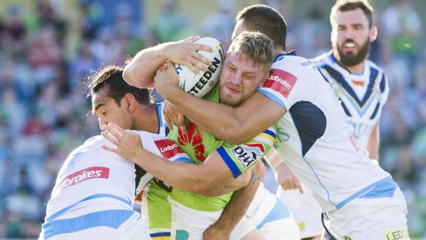 Tough going: Five-eighth Elliot Whitehead hits the Titans defence.