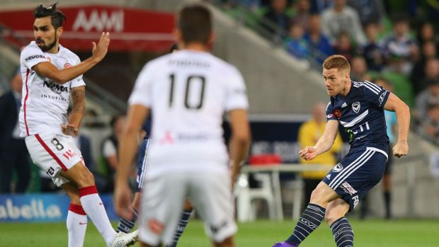 Oliver Bozanic of the Victory slots home one of his two goals.