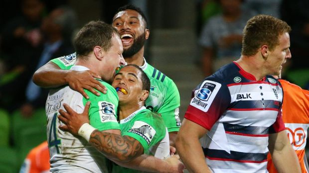 Try time: Jack Wilson of the Highlanders is congratulated by his teammates after scoring.