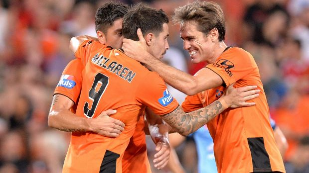 That'll do: Jamie Maclaren of the Roar celebrates with his teammates after scoring.