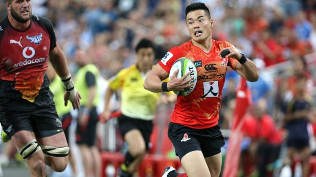 On the run: Akihito Yamada of the Sunwolves makes a break and scores.