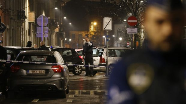 Police guard a check point during a police raid in the suburb of Schaerbeek in Brussels on Friday.