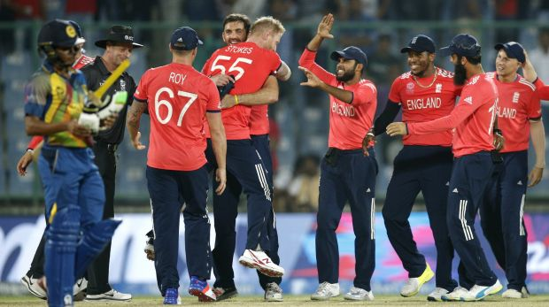 Relief: England players celebrate after defeating Sri Lanka by 10 runs.