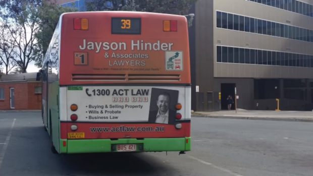 Jayson Hinder's ad on the back of an ACTION bus. The image is from a video on his Facebook page urging Labor members to ...