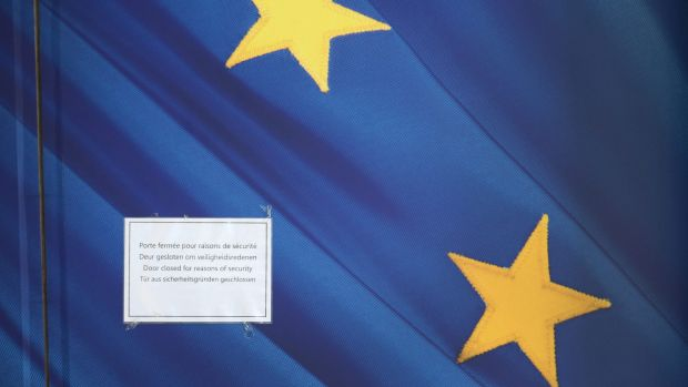 """A sign on a door of the EU Commission Headquarters in Brussels reads """"Door closed for reasons of security""""."""