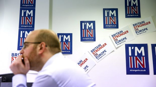 An employee works in front of campaign posters at the Britain Stronger In Europe campaign offices in London.