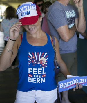 Hawaii voter Noelle Giambalvo shows off her Bernie Sanders' swag while waiting in line at the Hawaii caucus at Kailua ...
