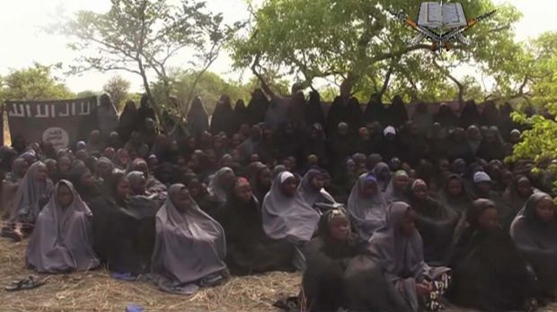 A still taken from video released by Nigeria's Boko Haram terrorist group in May 2014 shows missing girls abducted from ...