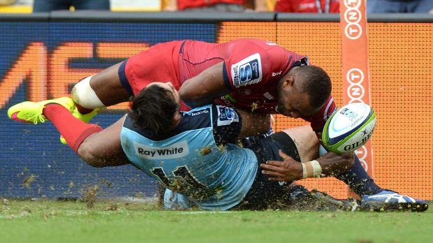 So close:  Eto Nabuli of the Reds is prevented from scoring a try by Zac Guildford of the Waratahs.