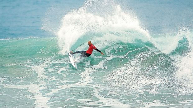 Old hand: Kelly Slater throws plenty of spray in solid swell at Bells Beach on Sunday.