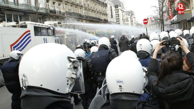Police use water cannon to try to disperse demonstrators at the site of one of the memorials to the victims of the ...