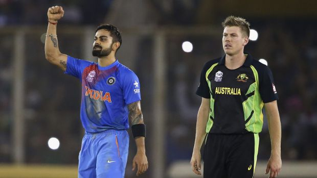 Virat-a-tat-tat: Virat Kohli celebrates victory as James Faulkner looks on.