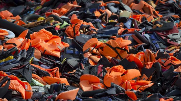 Thousands of discarded life vests dumped in a valley in hills above Mithymna, in Greece, on Sunday.