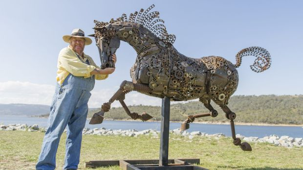 Artist Andrew Whitehead with his latest work, an iron horse titled Freedom Run, which he has entered in Jindabyne's Lake ...