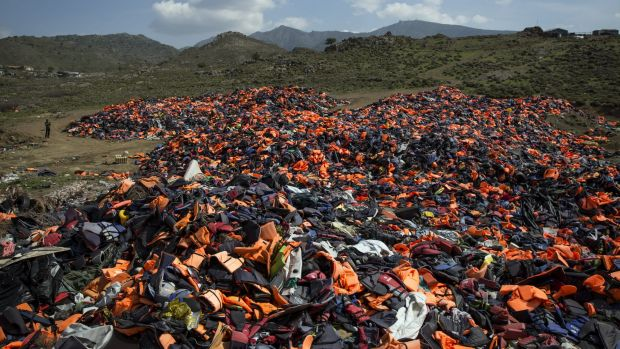 A pile of thousands of discarded life vests  dumped in a valley in hills above the town of Mithymna on Lesbos, Greece, ...