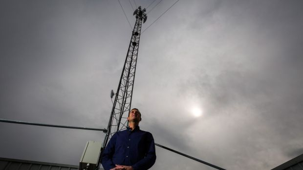 Jeremy Rich next to one of his internet towers on top of Hampton Park Shopping Centre in Melbourne's outer east.
