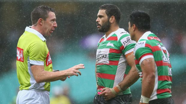 Laying down the law: Referee Jared Maxwell speaks to Greg Inglis and Kirisome Auvaa.