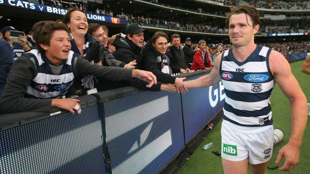 Emerging favourite: Patrick Dangerfield celebrates after the game with Cats fans.