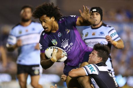 Felise Kaufusi of the Storm breaks the Sharks defence to score a try during the round four NRL match between the ...