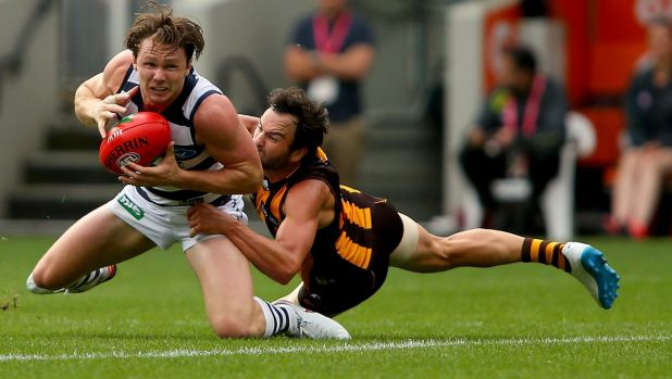 New Cat Patrick Dangerfield is under pressure from Jordan Lewis during the Easter Monday clash Hawthorn and Geelong at ...