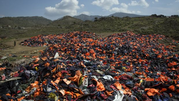 Discarded life vests litter a valley in Mithymna, Greece.