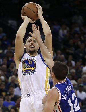 Shooting star: Golden State Warriors guard Klay Thompson nails a basket over Philadelphia 76ers opponent TJ McConnell in ...