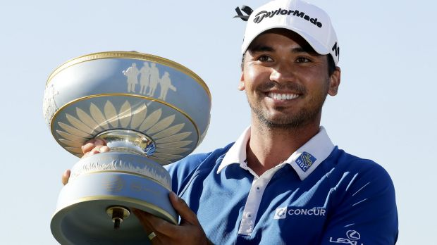Jason Day holds the trophy after winning the championship golf tournament at Austin Country Club in Texas.