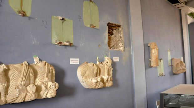 A photo released  by the Syrian state news agency SANA shows destroyed reliefs and relics from Palmyra's museum.