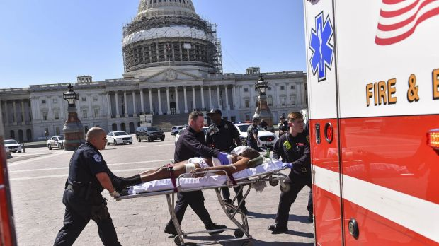 First responders transport the person believed to be the suspect in a shooting at the US Capitol complex on Monday.