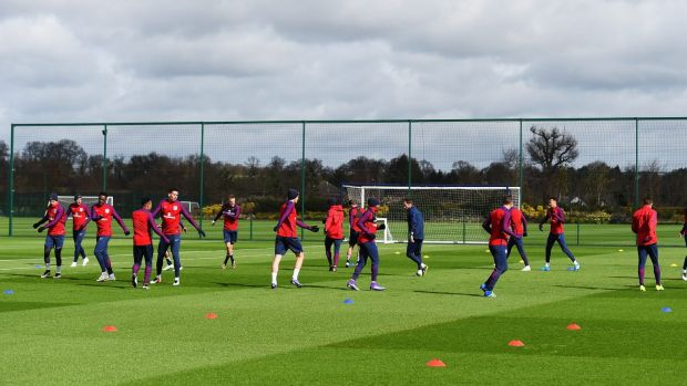 State of the art: The England football team warm up at Enfield during a training session.